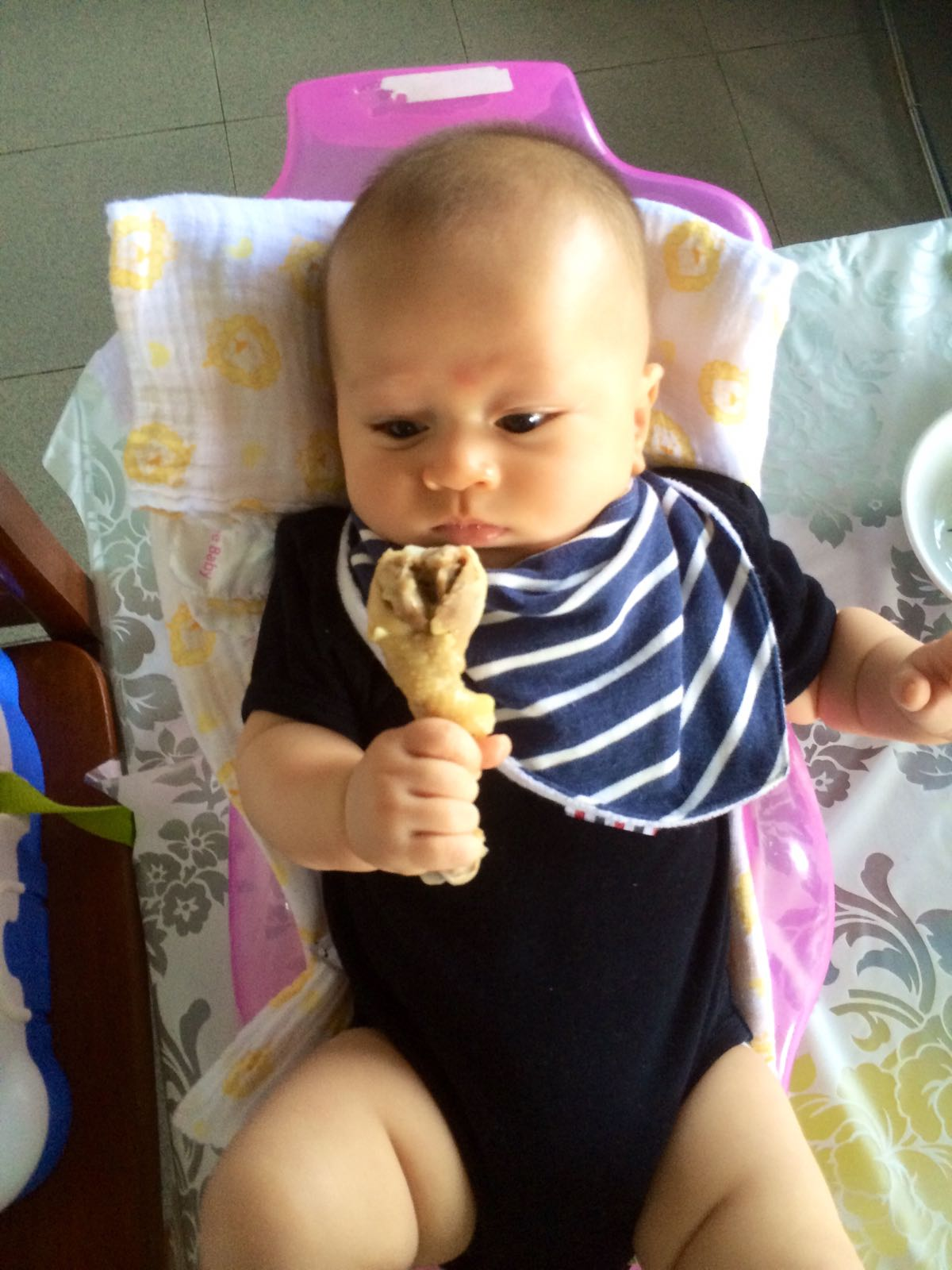 baby-ninja-skeptical-when-holding-chicken-drumstick